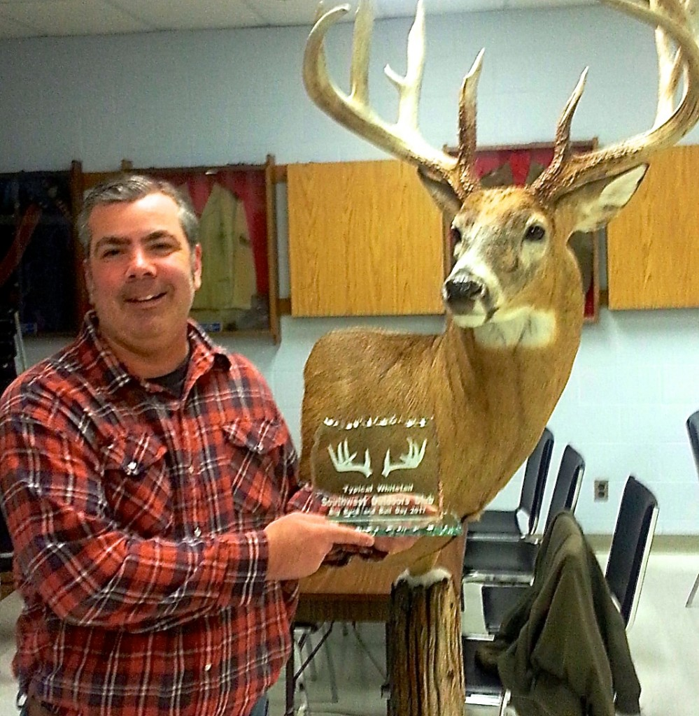 Doug Daniels with his huge monster buck, Ontario's 2nd largest crossbow buck. Awesome work by Taxidermy by Robert Beneteau